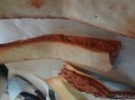 pâte à cigare formé en ailes pliées et garni de praliné au chocolat au lait et pailleté feuilletine